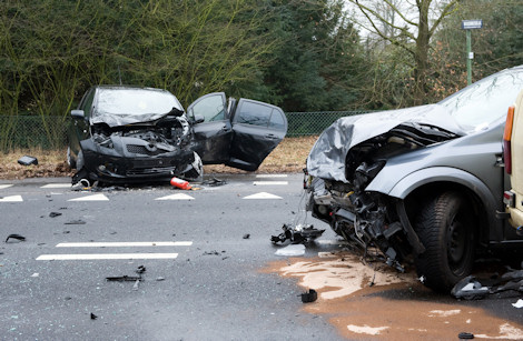Two cars who crashed into another car on a interstate road